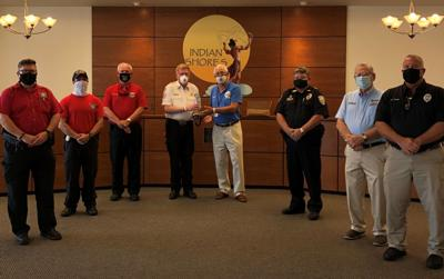 Indian Shores, fire district honor retired inspector