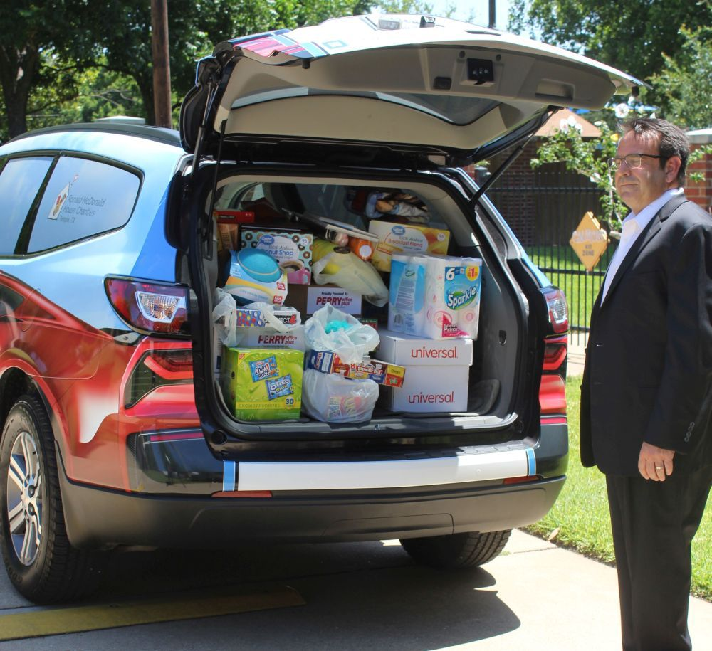 opens up the back of the chevrolet traverse being donated to the ronald mcdonald house of temple don ringler chevrolet collected items from the