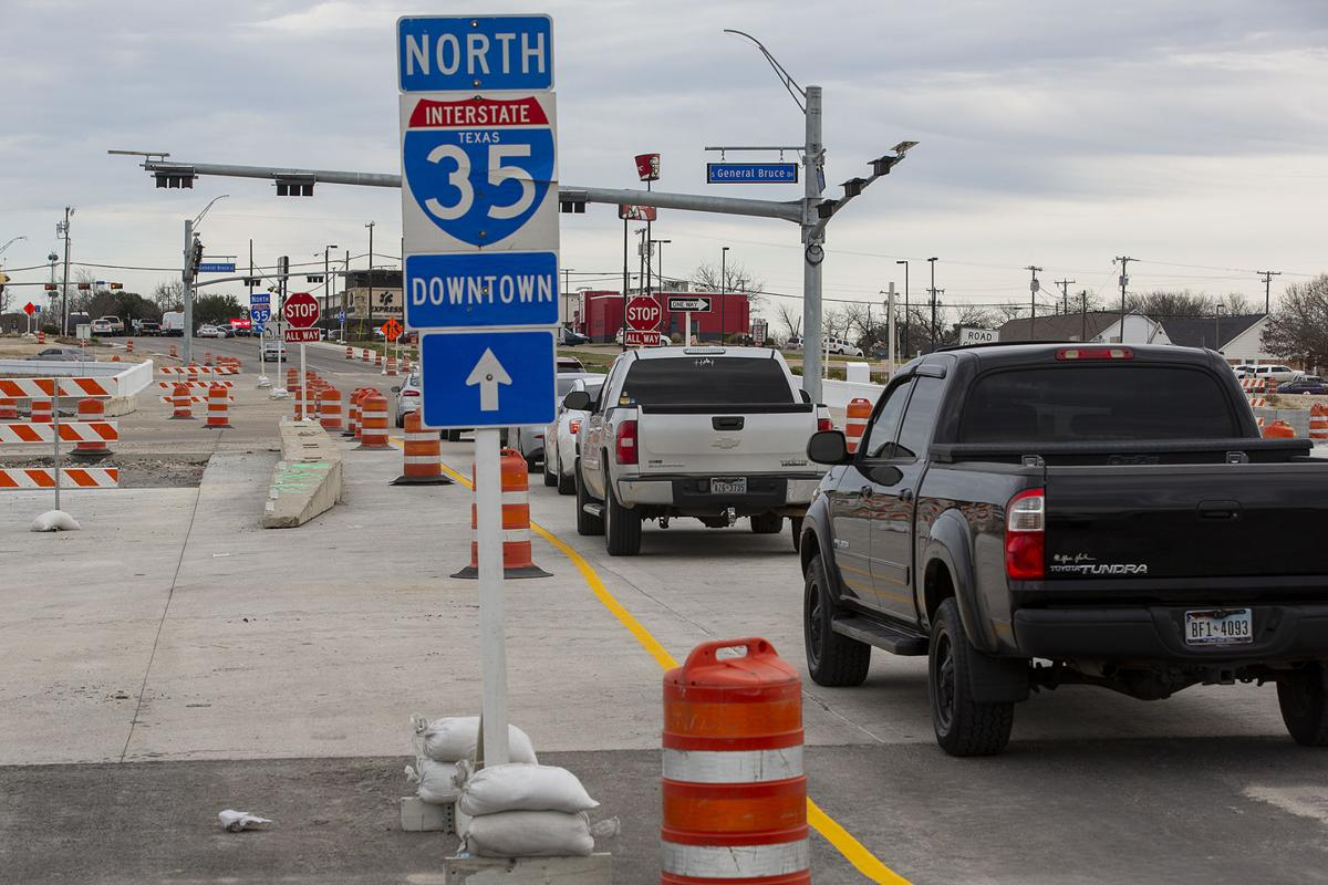 New stop signs added to Adams, Central intersections at I-35