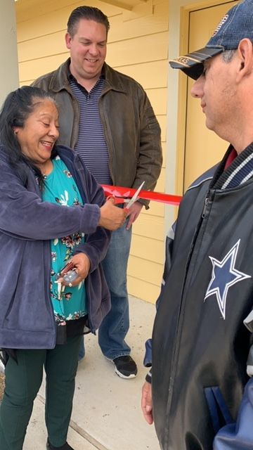 Rogers woman receives new home under city program
