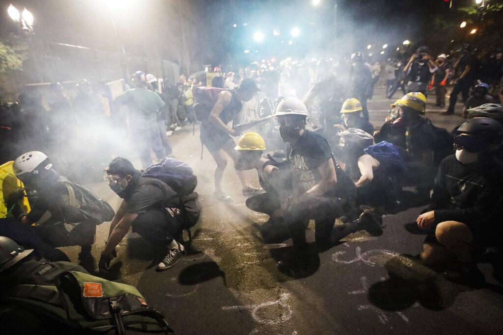 Sitting amid tear gas