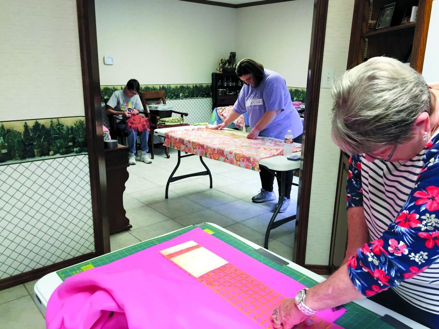 the gift of warmth volunteers from local church make blankets for