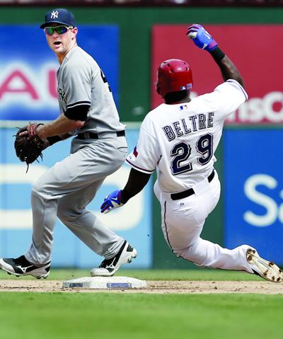 486805c8215bb Yankees second baseman David Adams tries to turn a double play after  forcing out the Rangers  Adrian Beltre on Thursday.