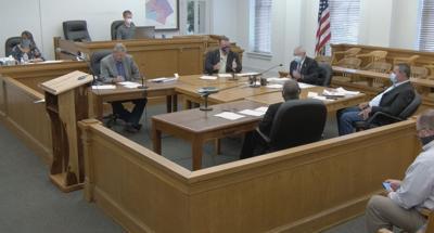 Commissioners revise mask order