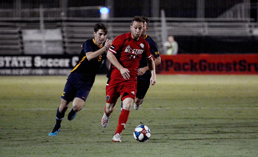 Gabarra dribbles the ball past ETSU defenders
