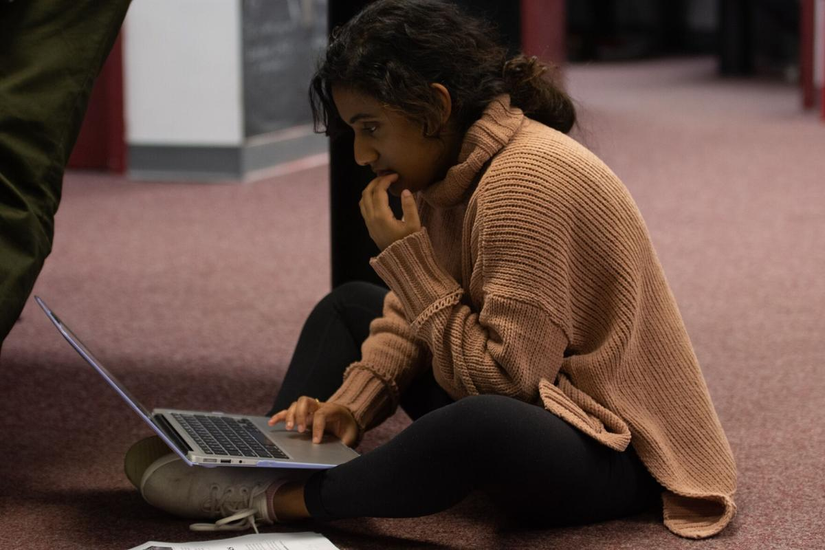 alicia girl on laptop tip sheet photo