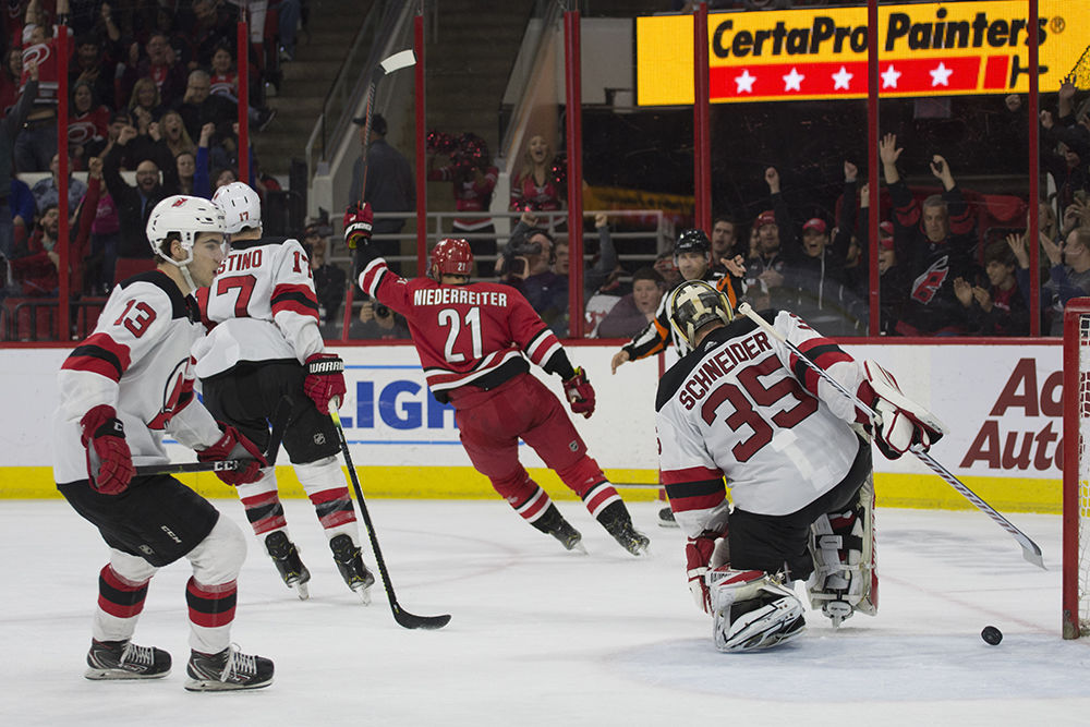 Hurricanes secure playoff berth with win over Devils