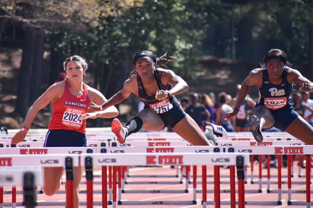 Alexis Postell Jumps Hurdle