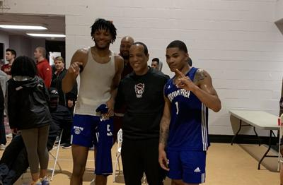 Shakeel Moore and Josh Hall with Kevin Keatts
