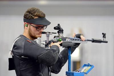 Tyler Lefebvre Holds Rifle