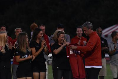 Page Marsh accepts commemorative jersey
