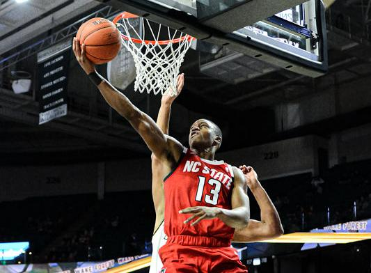 Red-hot shooting powers Pack men's basketball to first ACC win