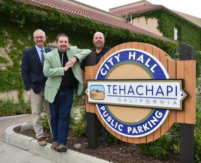 3 hosts City Hall Sign.jpg