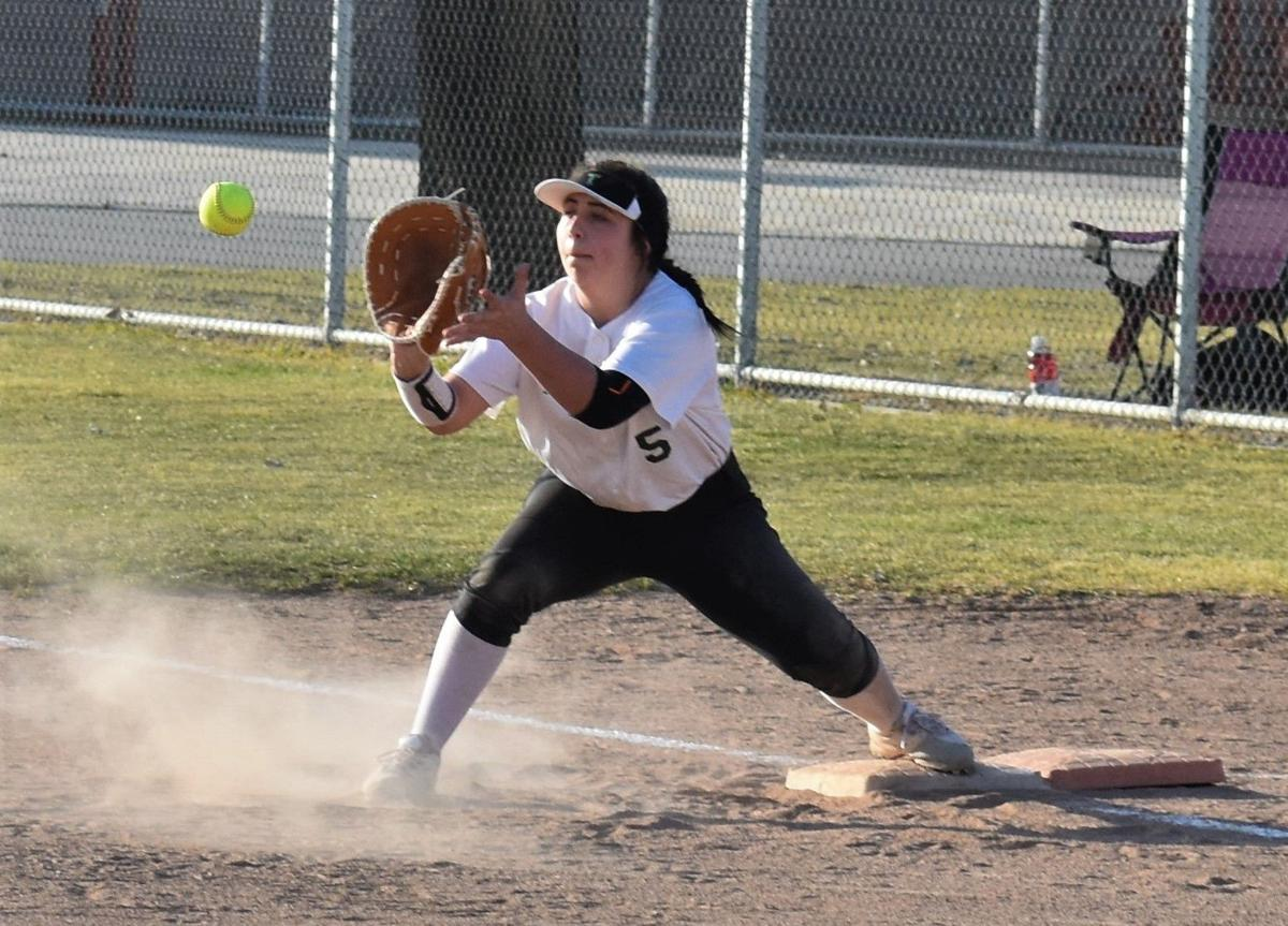 Kyndal Perkins makes the play at first..JPG