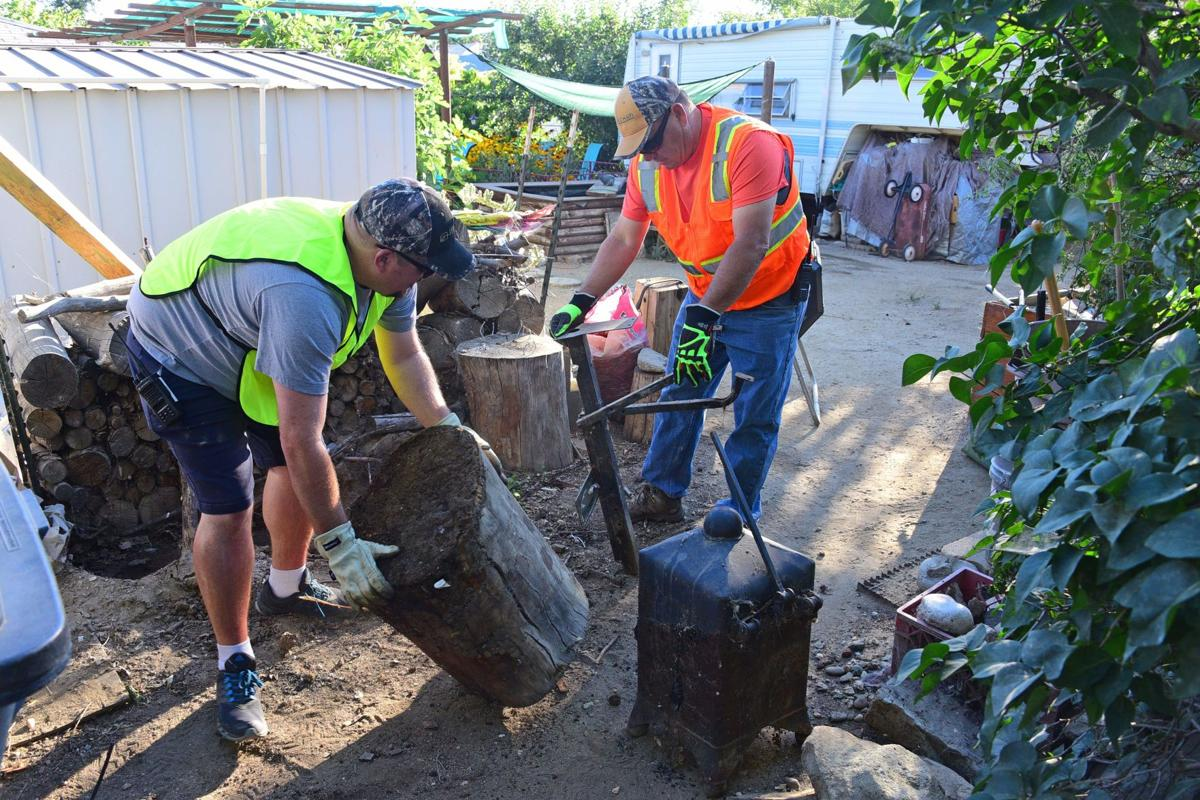 PHOTO GALLERY: City workers, church members and more volunteer for major neighborhood cleanup