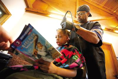 Students trade tales for trims at Dubuque park