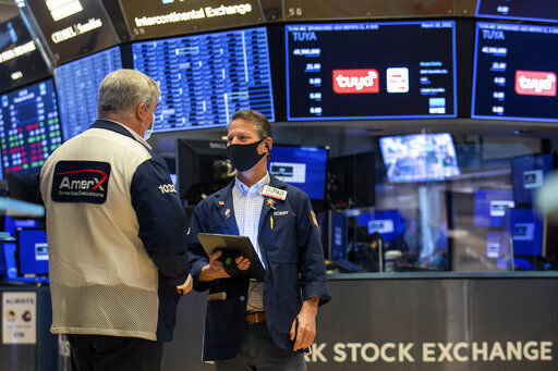 Wall Street closes lower, pulled down by IT and energy