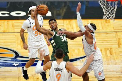 Antetokounmpo, Bucks pull away late to beat Magic 121-99