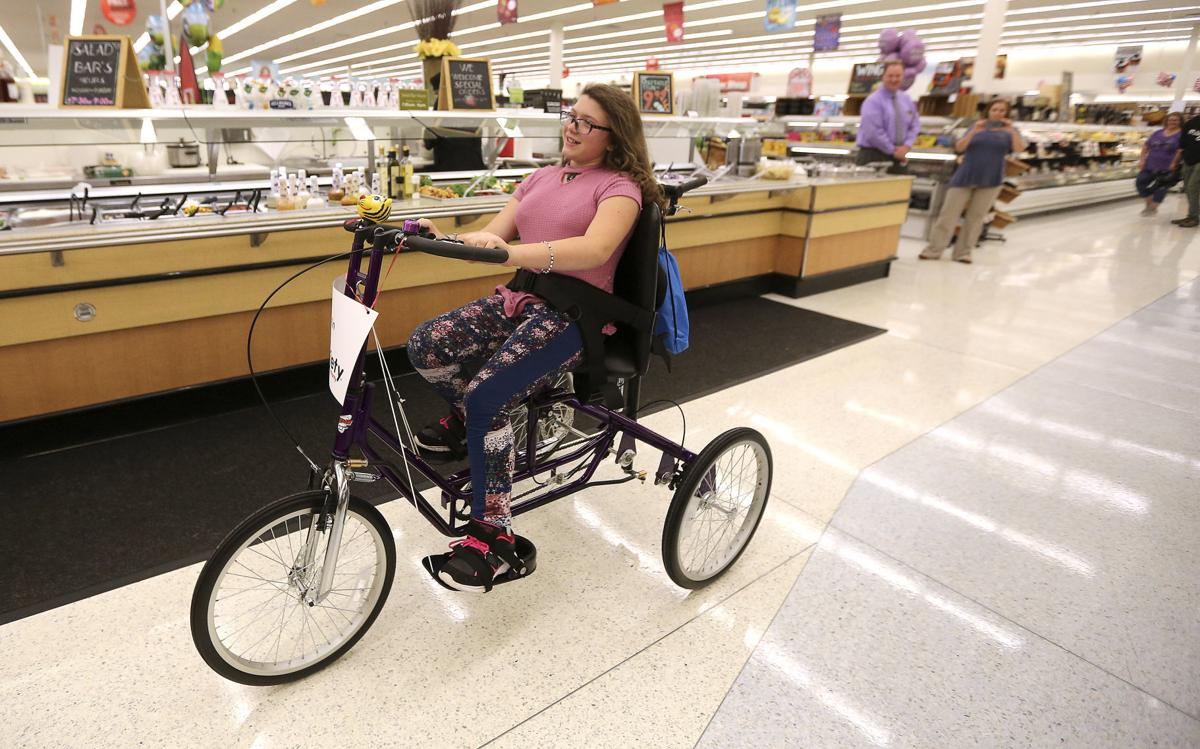 Charity gives specialized bike to Farley girl with cerebral