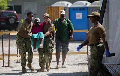 Haitians seek medical help from US Navy ship amid protests