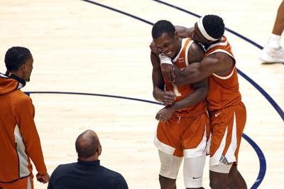 Jones' last-second 3 lifts No. 4 Texas over No. 14 WVU