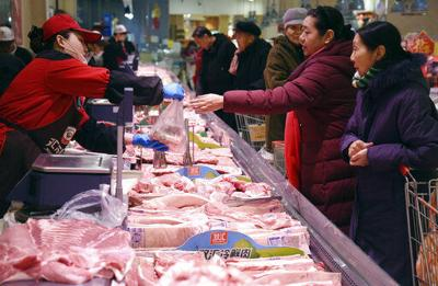 Soaring pork prices keep China's inflation at 7-year high
