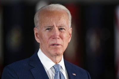 Biden campaign steps up hires despite money gap with Trump