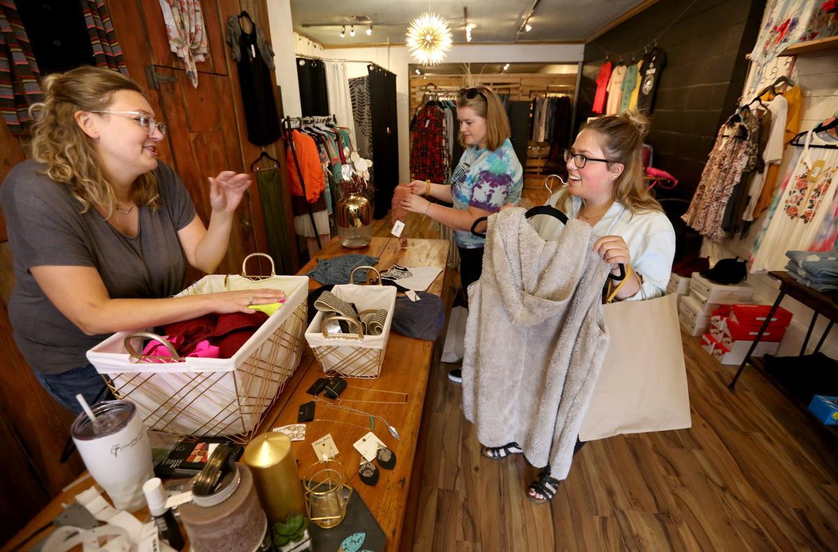 Biz Buzz: New boutique plots growth, longtime optical store