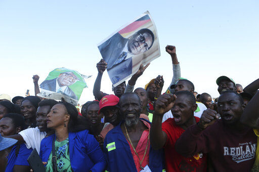 Few turn out as Mugabe is returned to a Zimbabwe in crisis