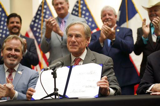 Texas governor signs new GOP voting restrictions into law