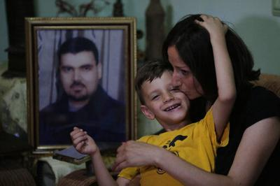 Caught in limbo, families of Syria's missing cling to hope