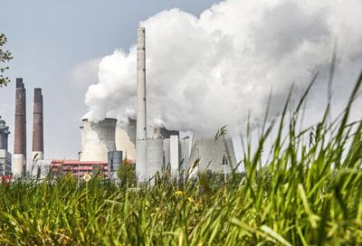 Energy agency urges bigger global push to cut emissions