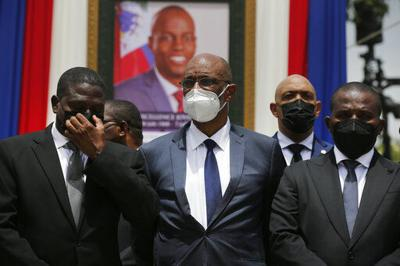 Haiti prosecutor asks judge to charge PM in assassination