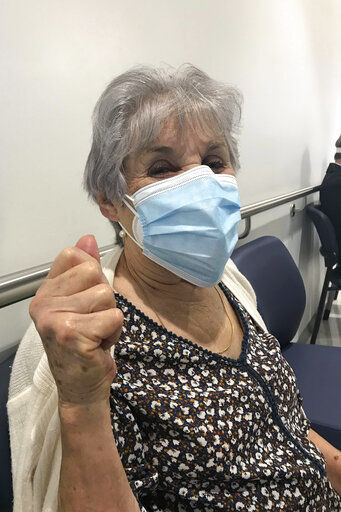 What's safe after COVID-19 vaccination? Don't shed masks yet
