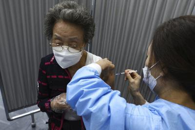 The Latest: Pfizer: Vaccine effective up to 6 months later