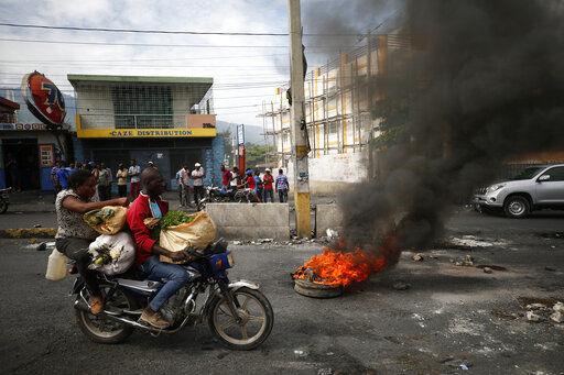 New protest hit Haiti amid demands that president resign