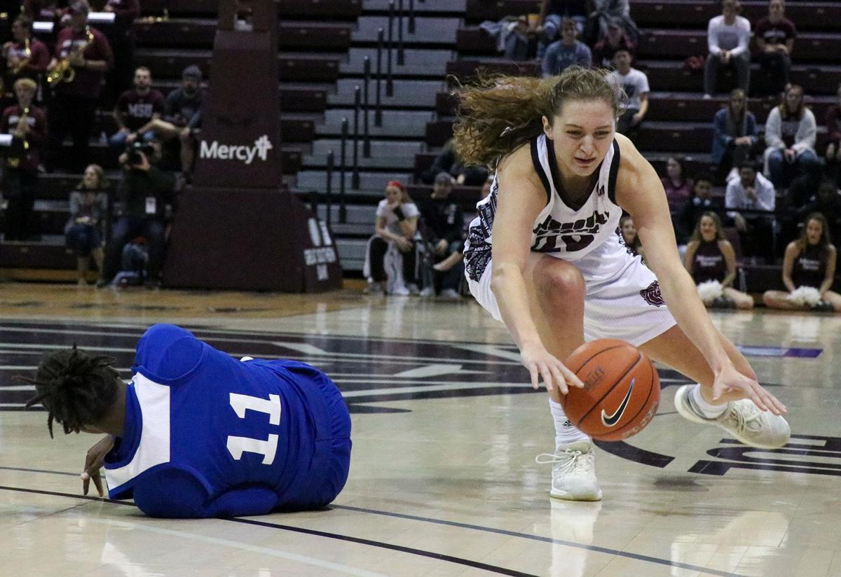 Alexa Willard dives after the ball