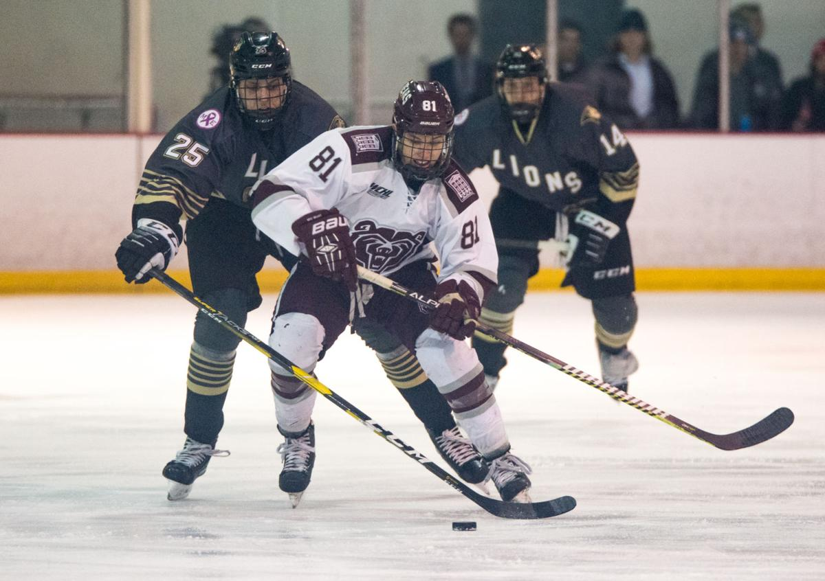 Brian Schumacher takes the puck up the ice