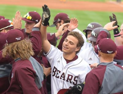Teammates surround freshman shortstop Jeremy Eierman after his grandslam against Central Michigan on April 2. It was Eierman's first career home run.