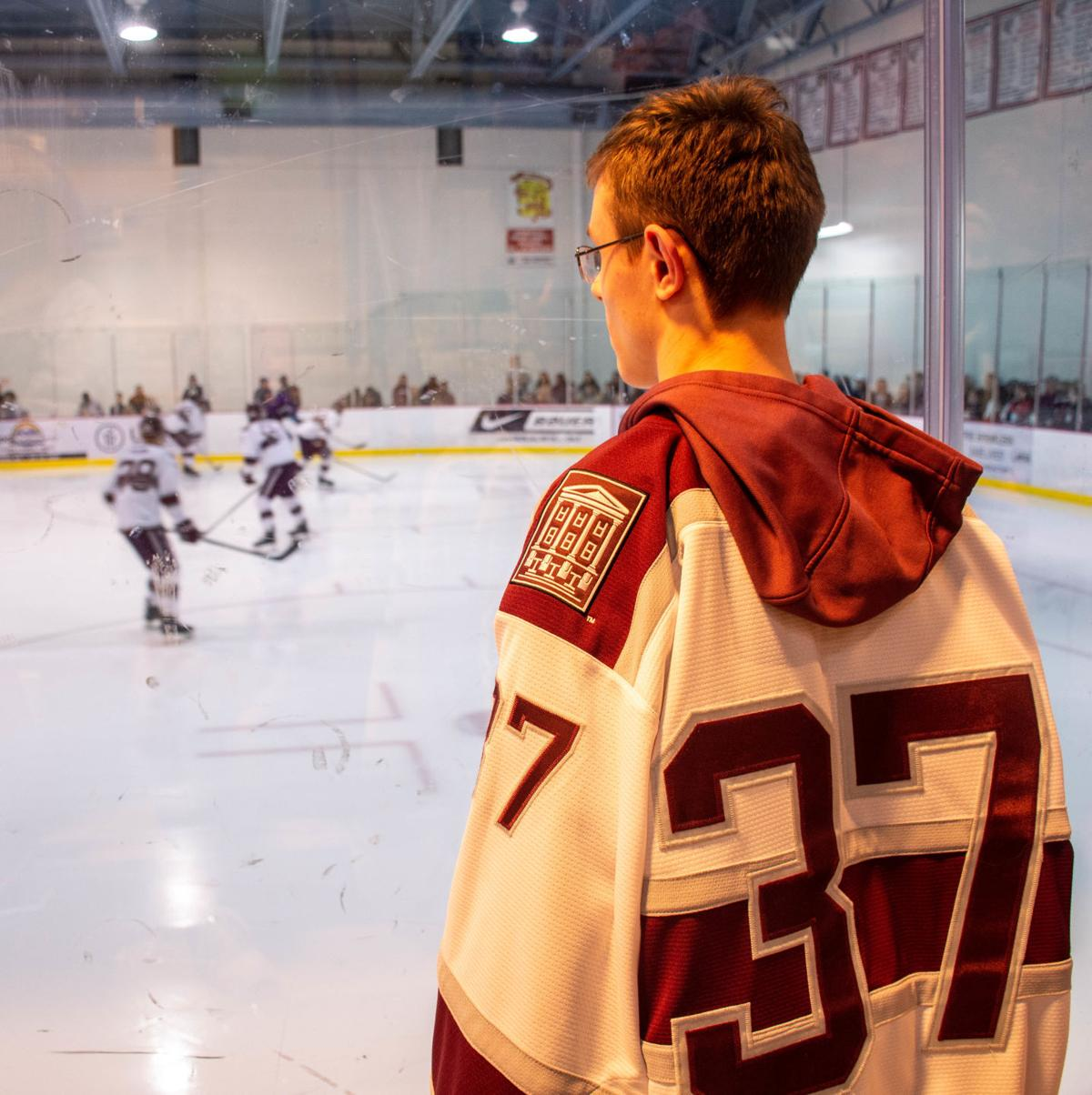 Dimitry Robertson watches the Ice Bears warm up