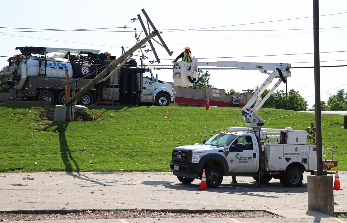 Ameren lineman works on securing a fallen telephone pole