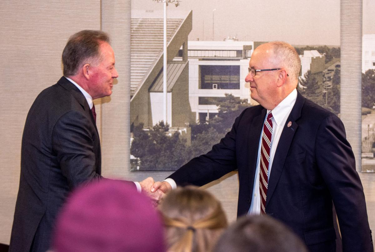 Clif Smart and Bobby Petrino shake hands