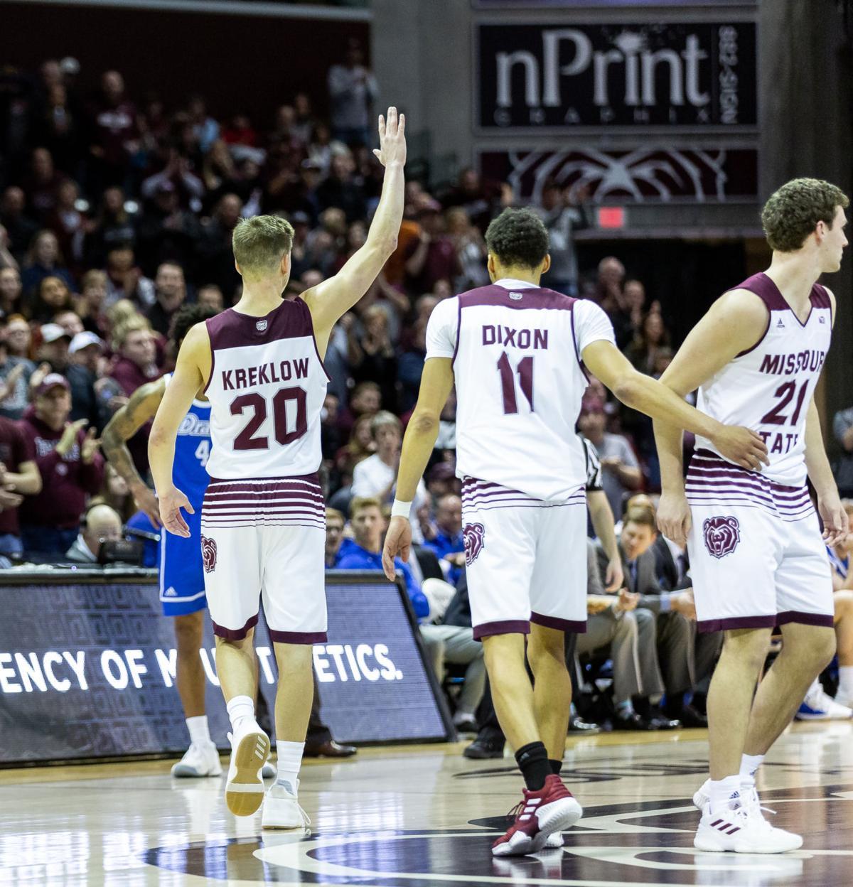 Jarred Dixon, Ryan Kreklow walk off the court