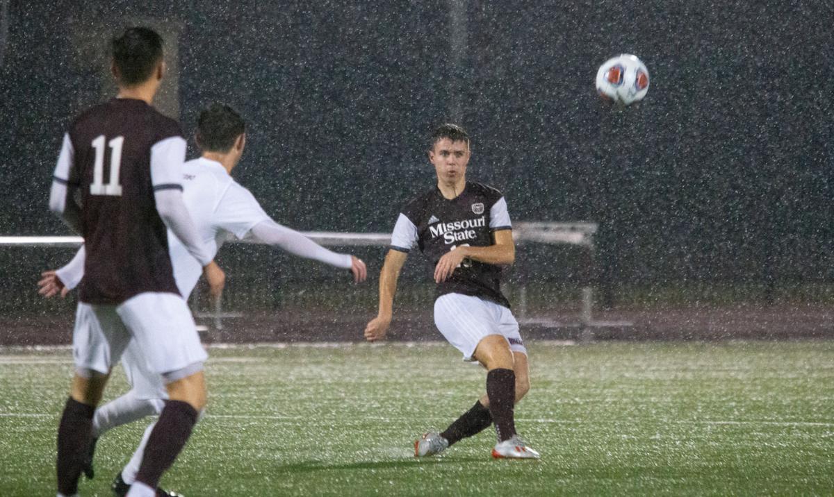 Jack Denton boots the ball through the rain