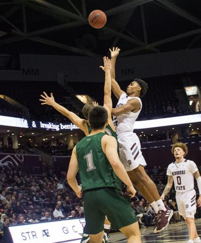 Josh Hall goes up against Cleveland State for the shot
