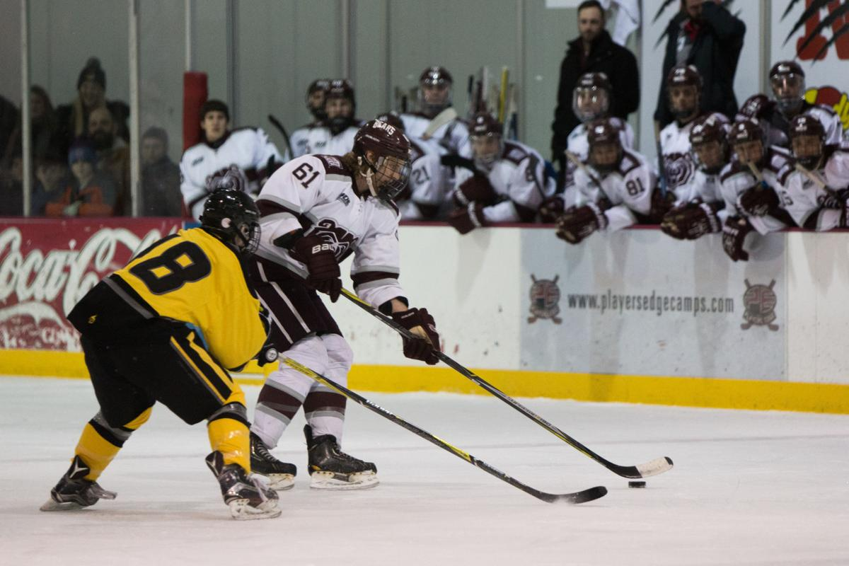 Carson Wornig protects the puck