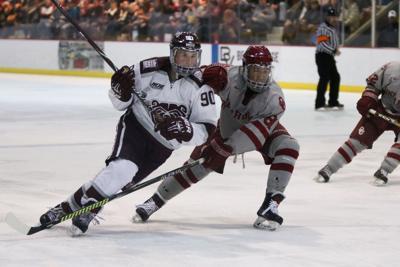 Nikita Salnikov skates past his opponent