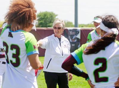 Holly Hesse talks with the softball team