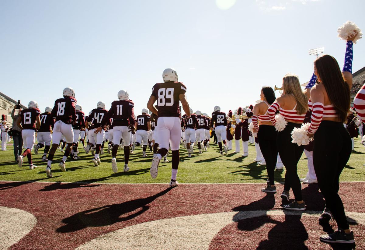 Football team runs on field