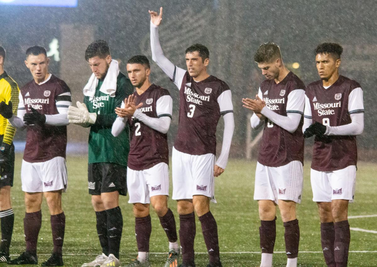 The Missouri State Bears clap as the starting lineups are announced